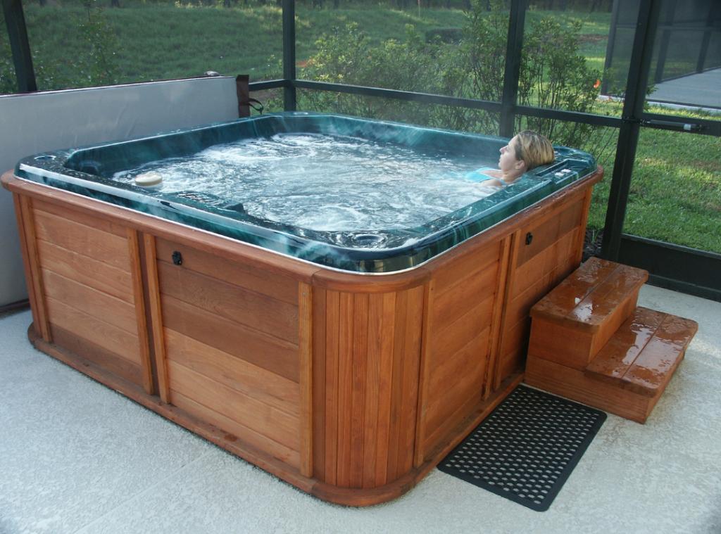 woman enjoying hot tub west houston